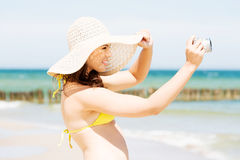 Summer woman talking pictures with digital camera Stock Photos