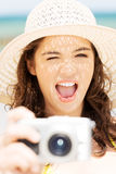Summer woman talking pictures with digital camera Royalty Free Stock Photography
