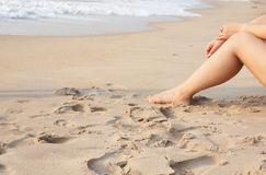 Summer. Woman walking barefoot on sunny beach in summer day Royalty Free Stock Photography