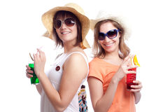 Summer women best friends drinking a cocktail in a. Women having a cocktail in a white background Royalty Free Stock Photo