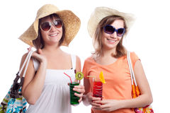 Summer women best friends drinking a cocktail in a. Women having a cocktail in a white background Royalty Free Stock Images