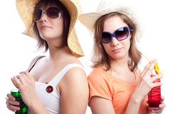 Summer women best friends drinking a cocktail in a Stock Images