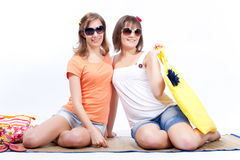 Summer women best friends in a white background. Women sunbathing in a white background Stock Image