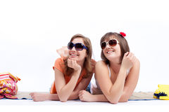 Summer women best friends in a white background. Women sunbathing in a white background Stock Photography