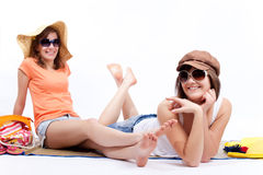 Summer women best friends in a white background. Women sunbathing in a white background Royalty Free Stock Image