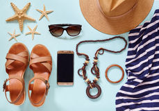 Summer women`s beach accessories for your sea holiday: straw hat, bracelets, leather sandals, sun glasses, beads Stock Images