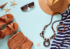 Summer women`s beach accessories for your sea holiday: straw hat, bracelets, leather sandals, sun glasses, beads Royalty Free Stock Photo