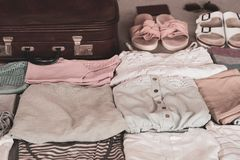 Summer women`s clothing neatly folded to be packed in a suitcase. royalty free stock image