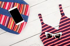 summer women& x27;s fashion with colorful striped bag, swimsuit, smar royalty free stock photos