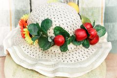 Summer women`s hat made of straw with fields. stock image