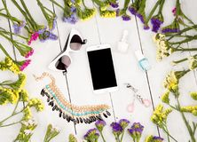 Summer women set with colorful flowers around smart phone, sungl. Travel concept - summer women set with colorful flowers around smart phone, sunglasses Royalty Free Stock Photo