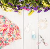 Summer women set with dress, colorful flowers, cosmetics makeup,. Travel concept - summer women set with dress, colorful flowers, cosmetics makeup, bijou and Stock Photos