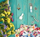 Summer women set with dress, colorful flowers, cosmetics makeup,. Travel concept - summer women set with dress, colorful flowers, cosmetics makeup, bijou and Stock Image