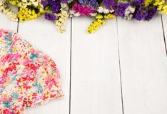 summer women set with dress and colorful flowers on white wooden Stock Photo