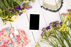 Summer women set with smart phone, dress, colorful flowers, cosm. Travel concept - summer women set with smart phone, dress, colorful flowers, cosmetics makeup Stock Photo