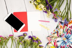 summer women set with smart phone, dress, colorful flowers, note royalty free stock photos
