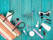 Summer women set with straw bag, sunglasses, shopping carts, cos. Travel concept - summer women set with straw bag, sunglasses, shopping carts, cosmetics makeup stock photography
