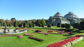Palm house in vienna with garden flowers on a sunny day royalty free stock images