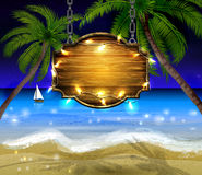 Summer wooden sign on tropical beach background Royalty Free Stock Image