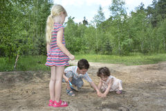 In the summer in the woods digging small children play ground. Stock Photos