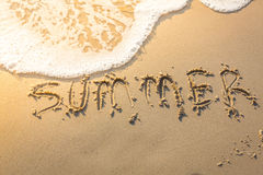 Summer word on sea beach Stock Photos