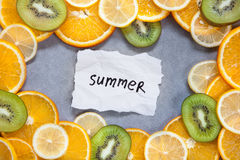 Summer - word with tropical fruits on gray background Royalty Free Stock Photo