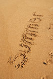 SUMMER word written on the sand Royalty Free Stock Photo