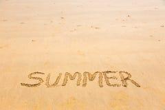 Summer word written on sand Royalty Free Stock Photos