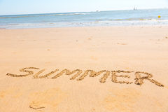 Summer word written on sand. Summer word written on beach sand Royalty Free Stock Images