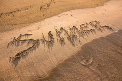 Summer word written in sand Stock Photography