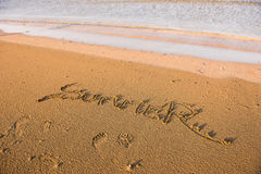 Summer word written in sand. Summer beach concept Royalty Free Stock Photos