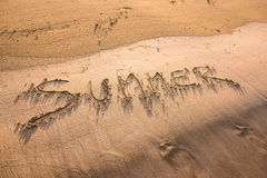 Summer word written in sand. Summer beach concept Royalty Free Stock Images