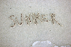 Summer word written on sand. Beach sand background texture Royalty Free Stock Photography