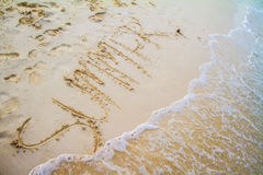 Summer word written on the sand Stock Photography