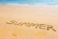 Summer word written on sand. Summer word written on a beach sand in sunny holiday day Stock Photography