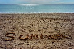Summer. Writing on a sandy beach Royalty Free Stock Photos