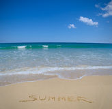 Summer written in beach sand stock photo