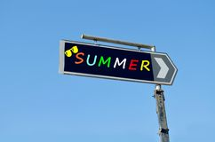 Summer written on blue road sign with arrow Stock Image