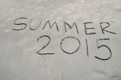 Summer 2015 written in the sand Royalty Free Stock Image