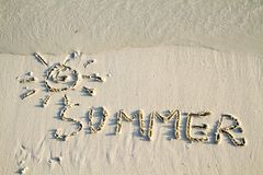 'Summer' written in sand. Royalty Free Stock Images