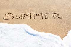 Summer written in the sand Stock Images
