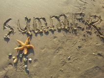 Summer written in sand Stock Photo