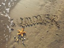 Summer written in sand Royalty Free Stock Image