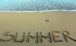 Summer written in the sand on a beach Stock Images