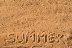 Summer written in the sand on the beach Royalty Free Stock Photo