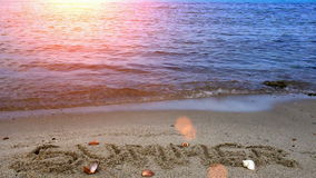 Summer written in the sand. Inscription the summer written on a sandy beach with a beautiful Mediterranean sea,video clip stock video footage
