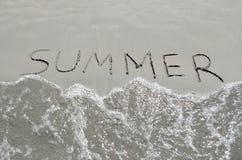Summer written in the sand Stock Photos