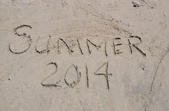 Summer 2014 in written in the Sand Stock Photos