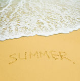 Summer written in a sandy tropical beach Royalty Free Stock Image