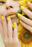 Summer yellow makeup and manicure. Stock Photo